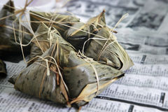 Glutinous rice dumpling. This is a Chinese glutinous rice dumpling, wrapped in bamboo leaf Stock Photos