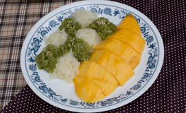 Glutinous rice with mangoes Stock Image