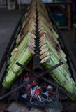 Glutinous rice roasted in bamboo joints. Royalty Free Stock Photos