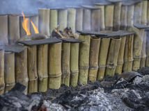 Glutinous rice roasted in bamboo. `Khao Lam` is Thai dessert , coconut milk with sticky rice in bamboo and selective focus Stock Photos