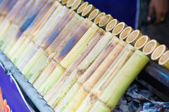 Glutinous rice roasted in bamboo tube Stock Images