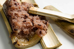 Glutinous rice roasted in bamboo  on white background Stock Image