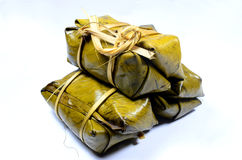 GLUTINOUS RICE STEAMED. IN BANANA LEAF stock photo