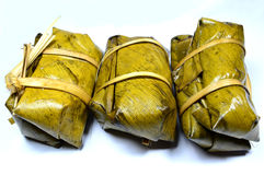 GLUTINOUS RICE STEAMED. IN BANANA LEAF stock photos