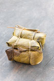 Glutinous rice steamed in banana leaf in packaging, Thai food, Thai tradition, selective focus. Royalty Free Stock Photography