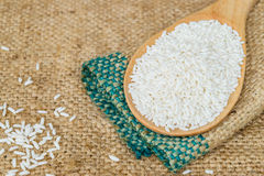 Glutinous rice in wooden spoon. With hemp sacks background Stock Images
