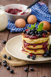 Glutten-free pancakes with jam and blueberries Stock Photos