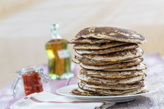 Glutten-free pancakes with jam and Maple syrup, ingredients, background. Glutten-free pancakes with jam and Maple syrup, bio healthy ingredients, on interior stock photo