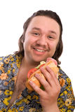 Glutton. Young man eats a sandwich royalty free stock photography