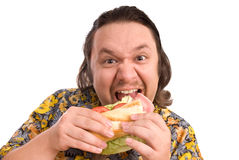 Glutton. Young man eats a sandwich Stock Photo