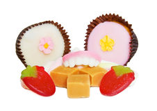 Gluttony - candy dentures eating mix of sweets Royalty Free Stock Photos