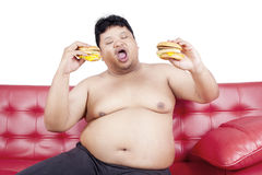 Gluttony person eat two burgers Royalty Free Stock Images