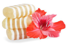 Glycerin soap. With the flower of the gladiolus Royalty Free Stock Photo