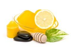 Glycerin soap, lemon and massage stones Royalty Free Stock Image