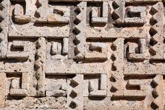 Glyph in archeologische plaats van Mitla, Mexico stock foto