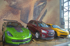 GM cars Chevrolet Camaro, Corvette Stingray C7 concept and Chevrolet Sonic RS Rally Car from new movie Transformers 4 Royalty Free Stock Image