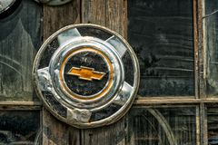 GM old hubcap. Vintage hubcaps house in Laval, Quebec stock images