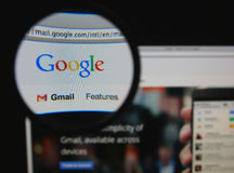 Gmail. Photo of Google mail homepage on a monitor screen through a magnifying glass Stock Photo