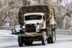 1941 GMC CCKW-353 Troop carrier. Adelaide, Australia - September 25, 2016: Vintage 1941 GMC CCKW-353 Troop carrier driving on country roads near the town of Royalty Free Stock Photos