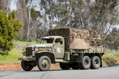 1941 GMC CCKW-353 Troop carrier driving on country road Stock Photos