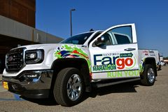GMC pickup advertises the Fargo Marathon. FARGO, NORTH DAKOTA-May 15, 2018: The new GMC pickup provided by Luther Family advertises the Fargo Marathon help Stock Photo