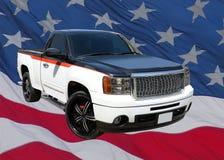 GMC pickup på USA flaggan royaltyfri bild