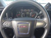GMC Sierra Truck Steering Wheel. The steering wheel and instrument gauge cluster of a GMC Sierra Pick-up truck Stock Photo