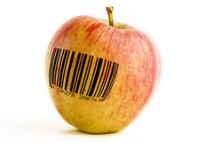 GMO Apple. A single apple with a bar code, genetically modified concept image royalty free stock photos
