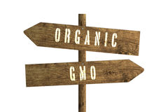 Gmo or Organic Farming Wooden Direction Sign. Stock Images