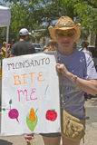 GMO Protester Holds Angry Anti Monsanto Sign Royalty Free Stock Photos