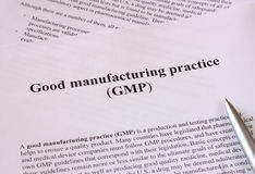 GMP - good manufacturing practice used for production and testing quality product. Good manufacturing practice used for production and testing quality product Stock Photo