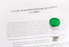 GMP - good manufacturing practice used for production and testing quality product Royalty Free Stock Images