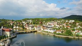 Gmunden aerial view, Austria. Gmunden city lakeside and Traunsee lake aerial panoramic view, Austria. Gmunden is a town in Salzkammergut region, Upper Austria stock footage