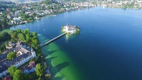 Gmunden, Austria across from the main part of the city. It is situated next to the lake Traunsee on the Traun River and is. Sail, Schloss Orth is a castle stock video