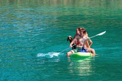 GMUNDEN, AUSTRIA, - AUGUST 08, 2018: Family with dog on Paddle Board at the lake. SUP. GMUNDEN, AUSTRIA, - AUGUST 08, 2018: Family with dog on Paddle Board at stock photos