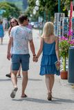 GMUNDEN, AUSTRIA, - AUGUST 03, 2018: Happy young couple walking with holding hands. stock photography
