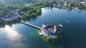 Gmunden, Traunsee, Lake Austria summer. Sail, Schloss Orth is a castle situated on lake Traunsee in Gmunden Austria, alps, Salzburg stock video footage
