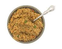 Gnälla smaksatta ris i en bunke med en gaffel Royaltyfri Bild