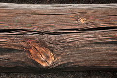 Gnarled wooden beam wall of an old building close Stock Photos