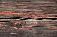 Gnarled wooden beam wall of an old building close Stock Photography