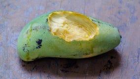 Gnaw marks on mango. Focused in hole stock images