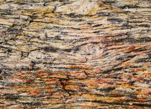 Gneiss rock - colorful graphic pattern or background. Gneiss & x28;pronounced & x22;nice& x22;& x29; is a metamorphic rock consisting mostly of quartz and Royalty Free Stock Image