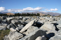 Gneiss rocks in New Zealand. New Zealand - huge boulder of gneiss rock from Remarkables mountains Stock Photo