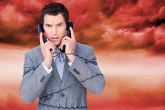 Gniewna biznesmen gmatwanina up w telefonów drutach Fotografia Stock