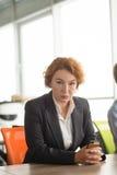 Gniewna biznesowa kobieta w biurze Obrazy Royalty Free