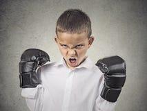 Gniewna chłopiec jest ubranym bokserskie rękawiczki Fotografia Royalty Free