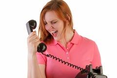 Gniewna kobieta na antykwarskim telefonie Zdjęcia Royalty Free