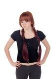 Gniewna nastoletnia dziewczyna ubierał w czerni z przebijaniem Obrazy Stock
