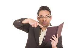 Gniewna nauczyciela mienia książka zdjęcia stock
