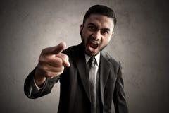 Gniewni biznesowi mężczyzna wskazuje wyrażenie Zdjęcia Stock
